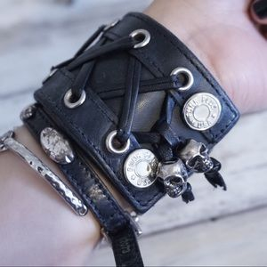 Vegan leather lace cuff with metal skull charms